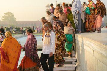 people standing near swimming pool